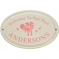 Palms Welcome to Our Pool Ceramic Plaque shown in Coral